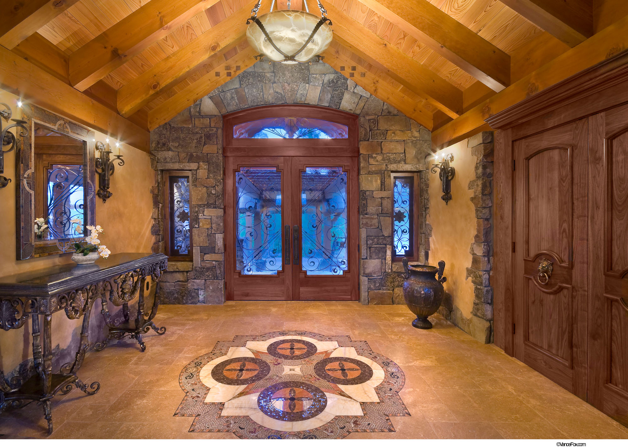 Entry area with door grills sconces and chandelier